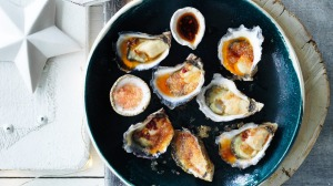 Freshly shucked oysters with finger lime and chilli dressing.