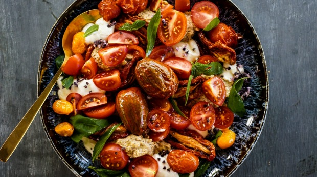 Three tomato salad with sunflower seed puree and whipped feta