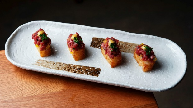 Go-to dish: Grass-fed beef tartare with crispy rice.