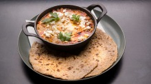 South African chakalaka-style baked eggs with flatbread.