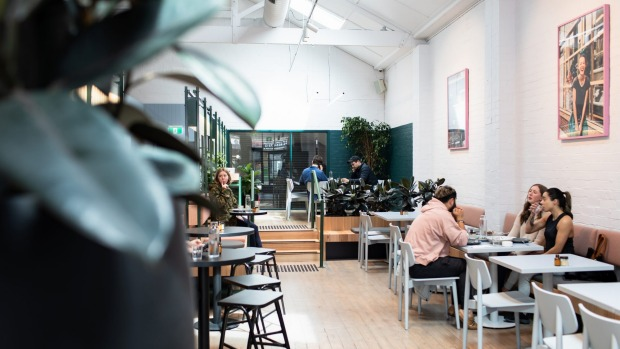 Lobbs cafe, Brunswick,features high ceilings, timber flooring and a subtle pastel palette.