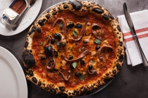 Pizza marinara, scattered with Ortiz anchovies.