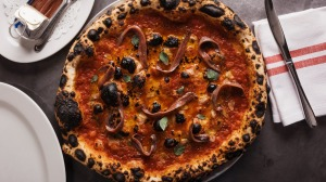 Pizza marinara scattered with optional Ortiz anchovies.