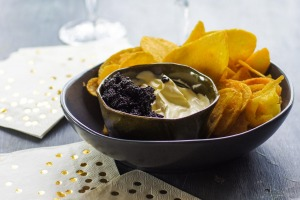 Kettle chips with champagne creme fraiche and caviar.