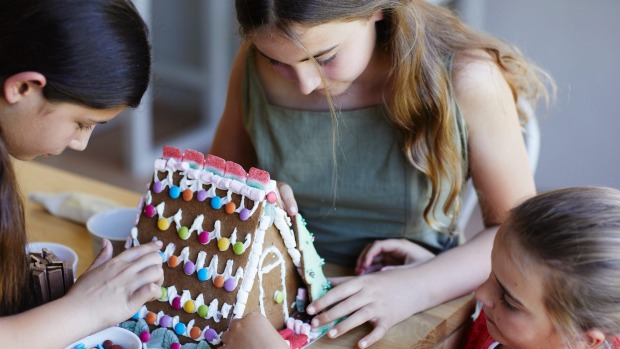 Decorating Phillippa's gingerbread house.