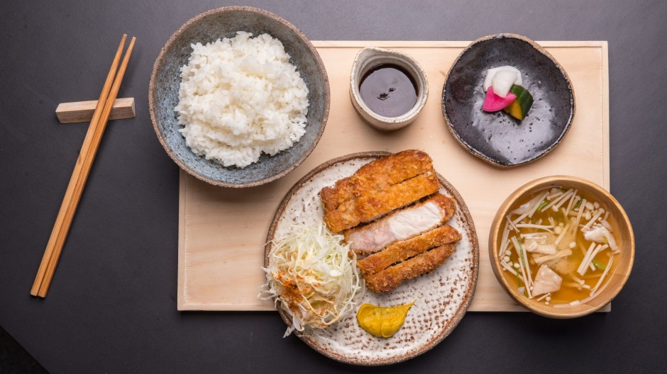 Pork tonkatsu lunch set with hot mustard, rice, miso and vibrant house pickles.