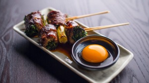 Sukiyaki skewer (wagyu beef) with raw egg yolk.