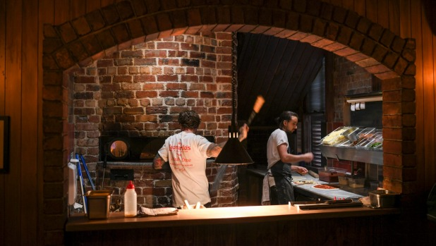 A brick arch frames the pizza oven.