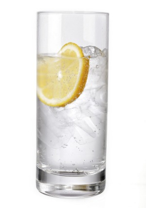 Old faithful: Mineral water with slice of lemon.