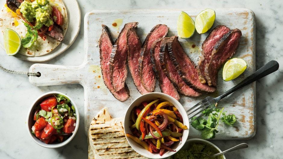 Skirt steak fajitas with guacamole and pico de gallo salsa.