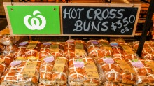 Woolworths and Coles have started selling hot cross buns and other Easter products in December.