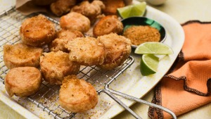 Little sweet potato fritters with chicken salt, lime and sour cream.