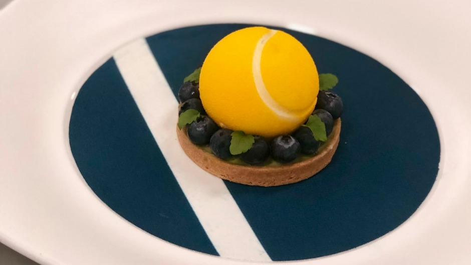 Nobu's bespoke Yuzu cheesecake filled with a passionfruit mango sauce.