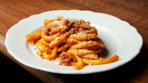 Pasta is done with care and depth; notably this Roman bucatini all'amatriciana.