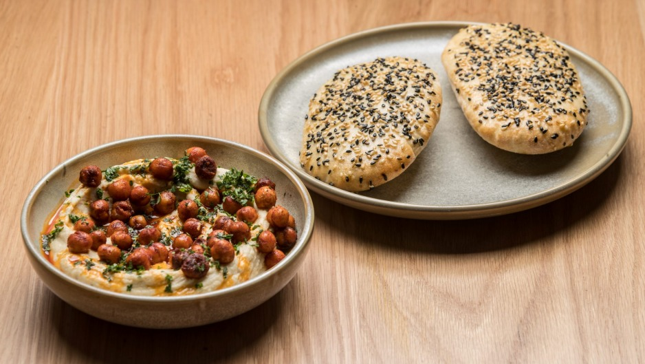 Fava bean hummus with crisp chickpeas and flatbreads.