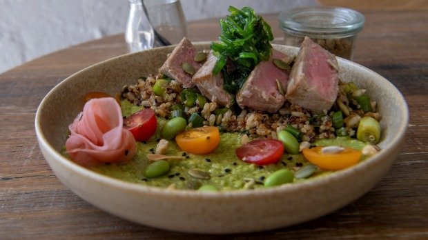 Seared-tuna bowl with quinoa and brown rice, crunchy with toasted nuts and seeds.