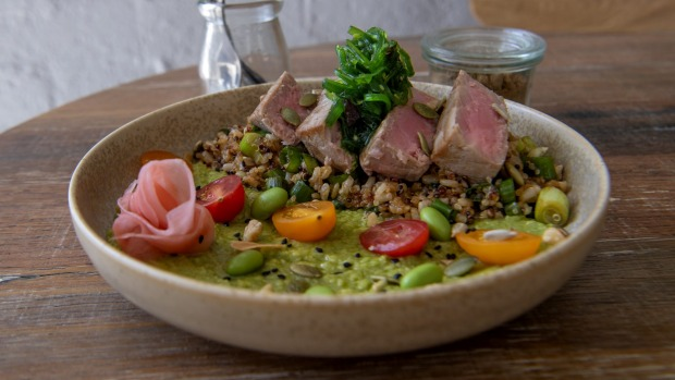 Seared tuna bowl with quinoa, brown rice, avocado, edamame, pickled ginger and seaweed.
