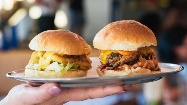 The Fisherman slider with calamari (left) and the Double Bacon Cheeseburger slider .