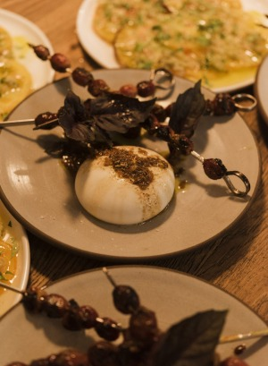 Ottolenghi's grape skewers and burrata served at Fred's.