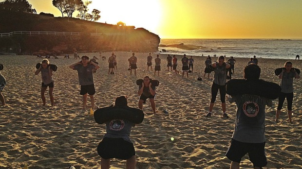Joining other bootcampers for a workout on the beach.