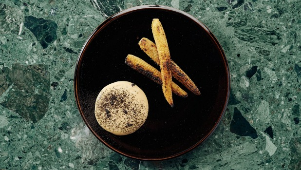 Cayenne-buttered baby corn with parmesan cream and black truffle.