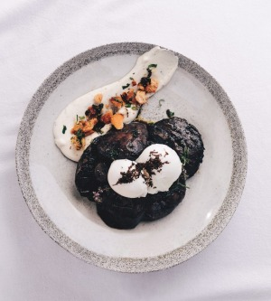 Portobello mushrooms, truffled chevre, gremolata migas and poached eggs from the cafe's upcoming  No Eggs on Toast book.