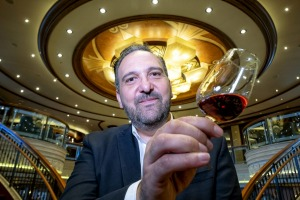"David Vitale tasting the malt whisky in the Queen Elizabeth's Grand Lobby.   He thought he detected a ""saltiness"" to the ..."