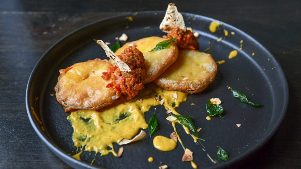 Deconstructed curry: Tempura eggplant with green capsicum and peanuts.