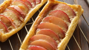 Easy nectarine and hazelnut frangipane tarts.
