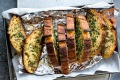 Garlicky goodness: Its mouth-watering flavour quickly gained favour to make garlic bread one of Australia's national dishes.