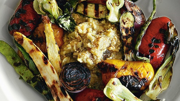 Eggplant caviar surrounded by summer vegetables.