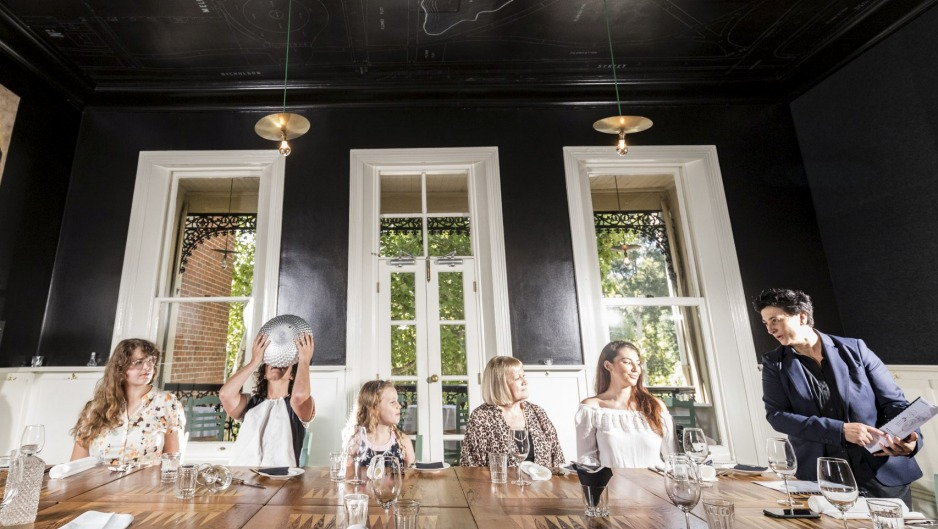 Angie Giannakodakis of Epocha (right) explains good table etiquette to Stefany, Lani, Ann and Laura, as Dani Valent ...