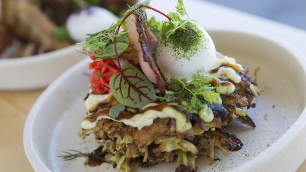 Okonomiyaki (savoury pancake) with bacon and poached egg.