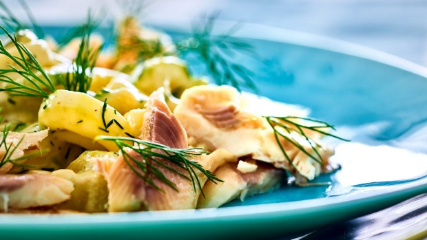 Traditional Bavarian dish smoked trout with stewed cucumber.