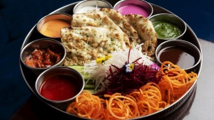 Pappadum and naan platter served with zippy chutneys.