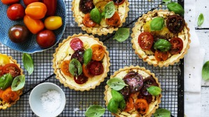 Tartlets topped with seasonal tomatoes.