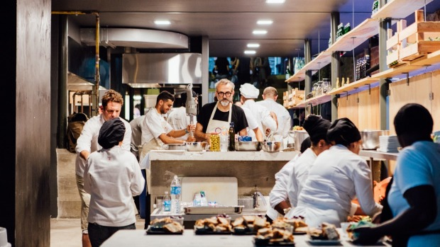 Massimo Bottura and his chefs at Refettorio Gastomotiva in Brazil.