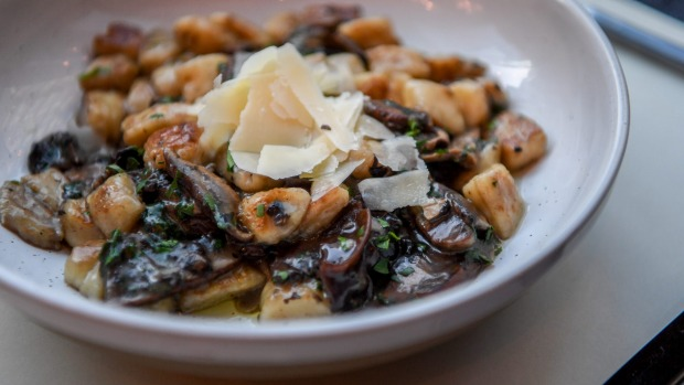 Pan-fried potato gnocchi with mushrooms.
