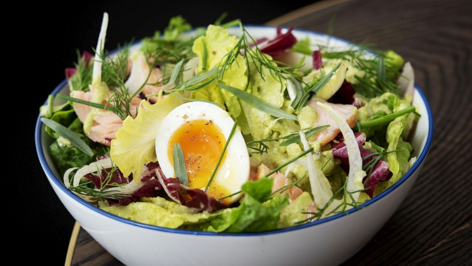 Slow-cooked salmon baby gem soft-boiled egg salad.