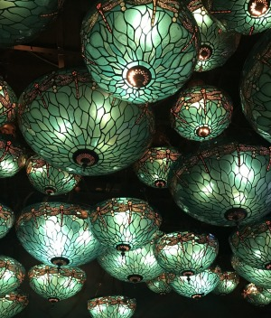 The ceiling at Hong Kong's Dragonfly is covered in turquoise Tiffany-style stained-glass lights.