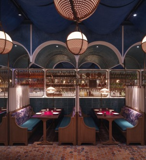 At John Anthony, Hong Kong, the ceilings are draped with fabric coloured with plant-based dyes.