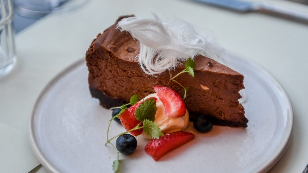 Chocolate malt cheesecake with mascarpone, berries and fairy floss.