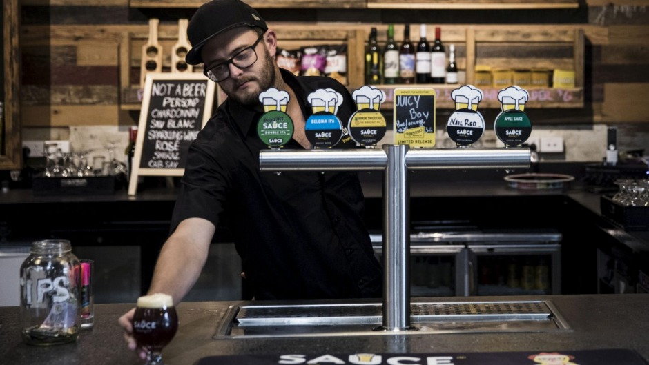 Tap room manager Dave Fitzpatrick of Marrickville's Sauce Brewing Co, which has teamed with other breweries to self-fund ...