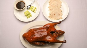 The signature Peking duck is presented tableside, then whisked off and assembled into pancakes.