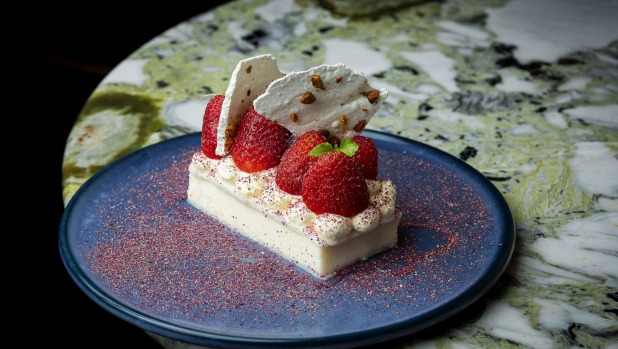 Layali luban (Nights of Lebanon) sees semolina rose pudding dressed up with pistachio meringue and summer berries.