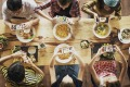 Table talk: 'It's an action that's become ingrained in people's DNA. As soon as food lands in front of them, the phone ...