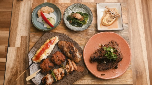 Tori set with miso, yakitori, fried chicken and little plates of pickles.