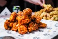 Korea's biggest fried chicken chain Pelicana has flown into Melbourne.