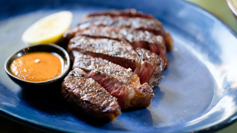 300g grass-fed Brooklyn Valley rib eye with grilled lemon and black garlic barbecue sauce.