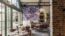 The Glebe Hotel dining room, with a mural by Sydney artist, Indigo Jo.